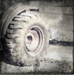 Tractor tire stuck in mud